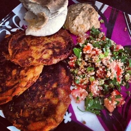 Snack plate with leek fritters, tabbouleh, & hummus