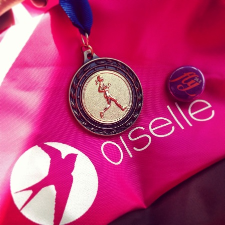 My medal and a side of my Oiselle spike bag